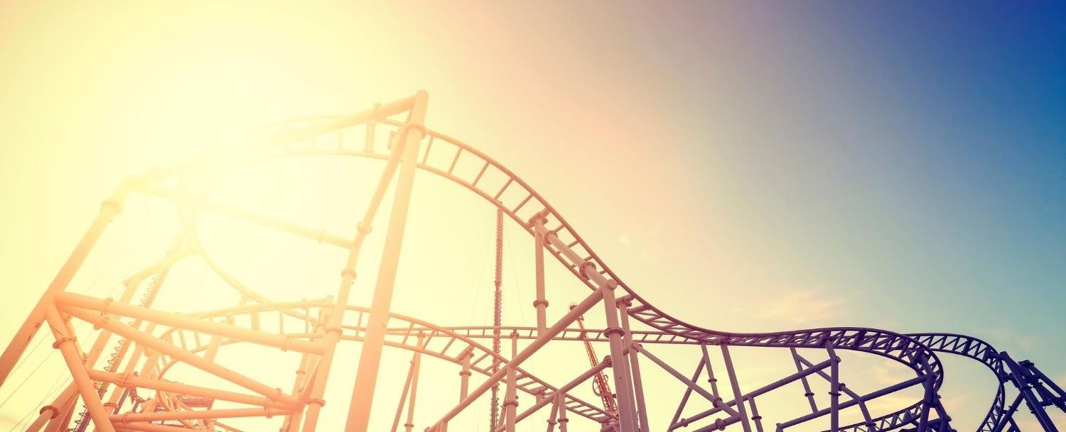 Rollercoaster at sunset like one you might see at a San Diego amusement park