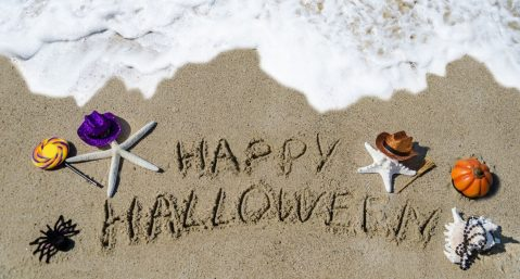 Happy Halloween written in the sand in San Diego in October